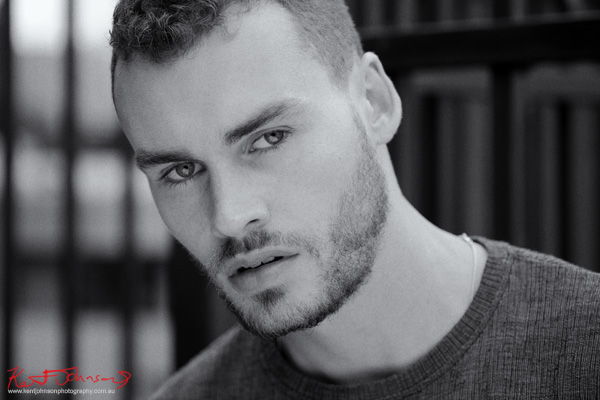 Male model headshot, close up style in black and white, photographed on location by Kent Johnson.