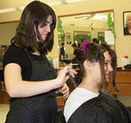Cosmetology Junior Alexandra Ostergren from Franklin who is cutting Cloey Murphy's hair