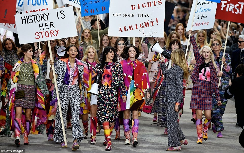 Models lead a feminist march for the Chanel Spring/Summer 2015 Paris Fashion Week Show