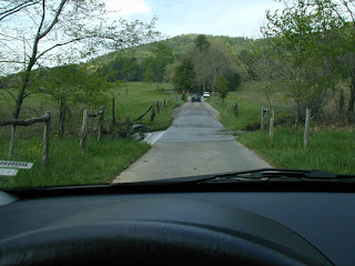 A stream crossing on the single lane road that loops around the cove.
