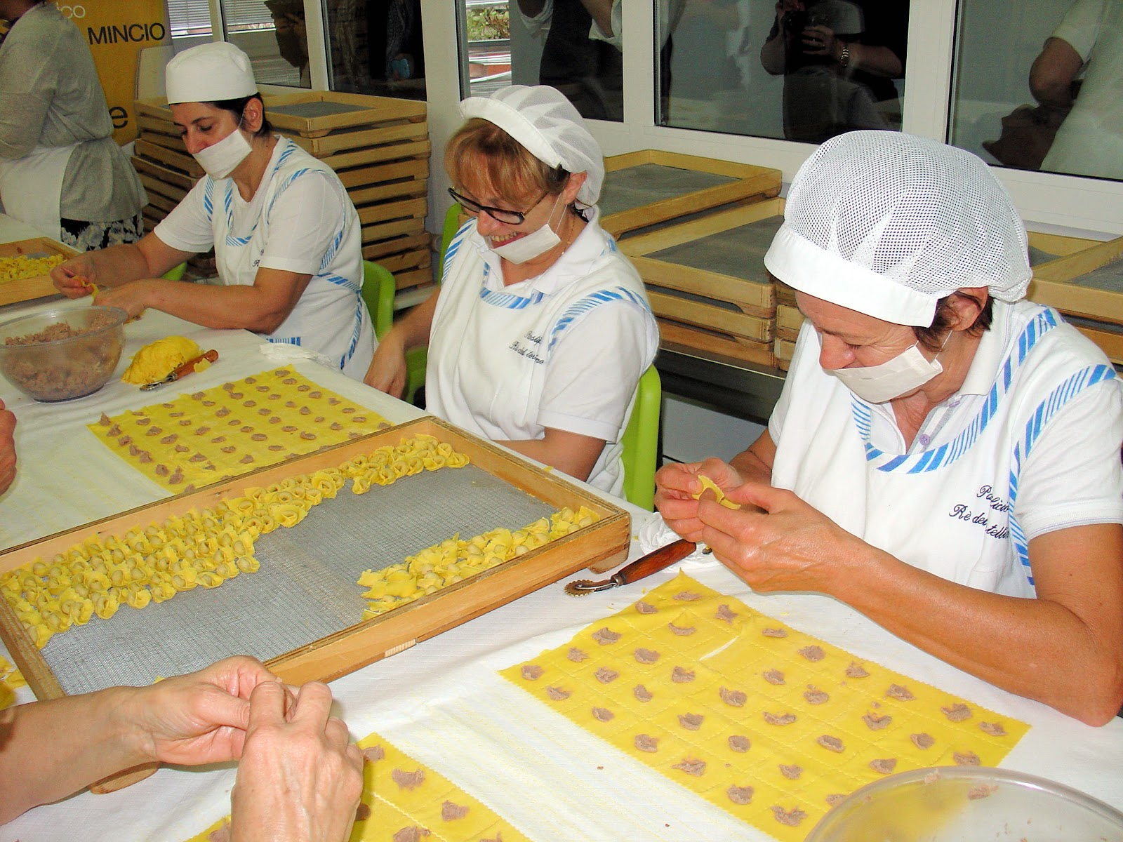 Hand folding tortellini in the traditions passed down by the generations.