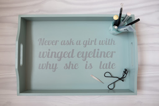 Tray stencilled with slogan Never ask a girl with winged eyeliner why she is late.  Cut with Silhouette Cameo using the free font for download from Silhouette UK Blog created by Nadine Muir from the Lobster font