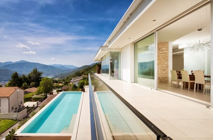 Terrace and swimming pool in Beautiful House Lombardo by Philipp Architekten