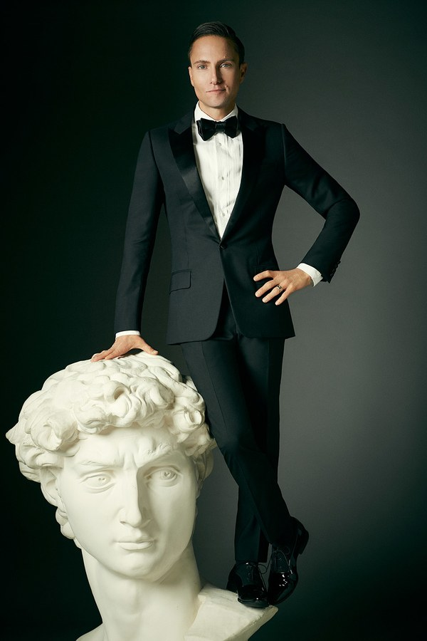 Designer Ken Fulk in tuxedo on huge David sculpture bust