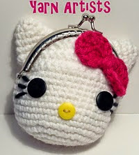 http://www.ravelry.com/patterns/library/little-kitty--hello-kitty-inspired-coin-purse-pattern