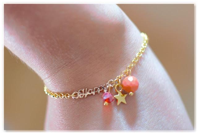 bracelet Happy doré, étoile dorée et perles rouge et orange