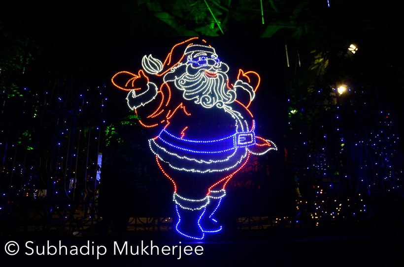 Few days back we shared Christmas post on our facebook page and one of my blogger friends Subhadip Mukherjee mentioned about Kolkata Christmas Celebrations. He shared more details about the celebrations in his own city. We had few mail exchanges and he offered to share these photographs on Travellingcamera.com. Nothing can be better that showcasing the celebration in own city. Check out this Photo Journey with all photographs clicked by Subhadip. Do check some of the links mentioned below where you can find more about Christmas in Kolkata.
