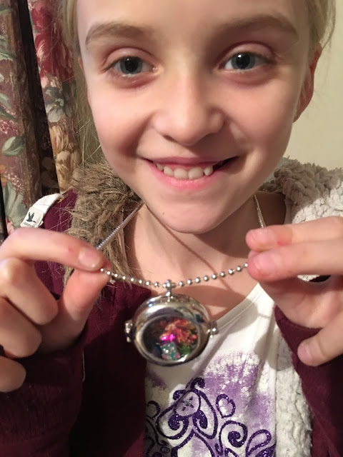 Proudly wearing her locket made withMyStyle Craft Make Keepsake Lockets from Interplay