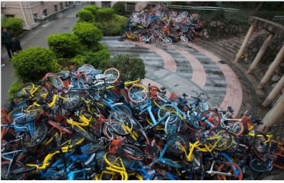 http://www.scmp.com/news/china/society/article/2062595/more-500-rented-bikes-many-vandalised-left-dumped-piles-near