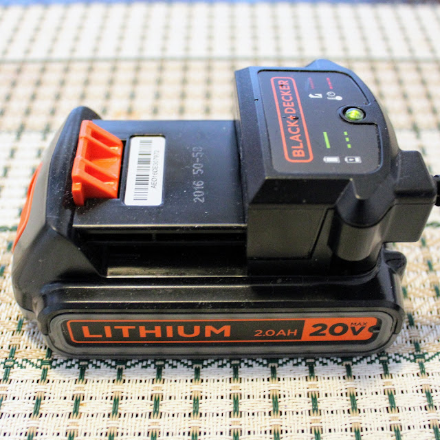 Black & Decker 3 in 1 Cordless Mower - The lithium battery and charging dock.