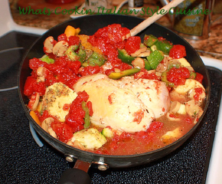 This is a one pan meal with boneless pork, tomatoes, peppers simmered low in a fry pan with mushrooms
