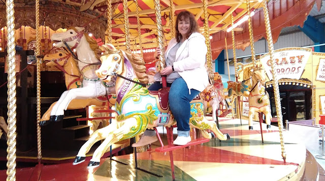 Riding the carousel at the Fairground museum