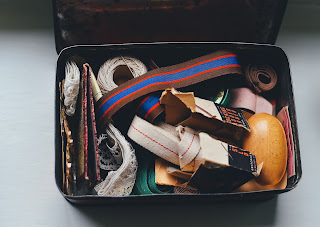 a storage bin with a jumble of items