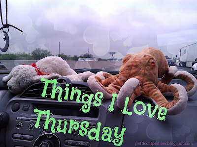 A plushie dog and octopus sitting on the dashboard of a car.  Text reads: Things I Love Thursday