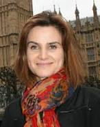 Jo Cox standing outside the Palace of Westminster