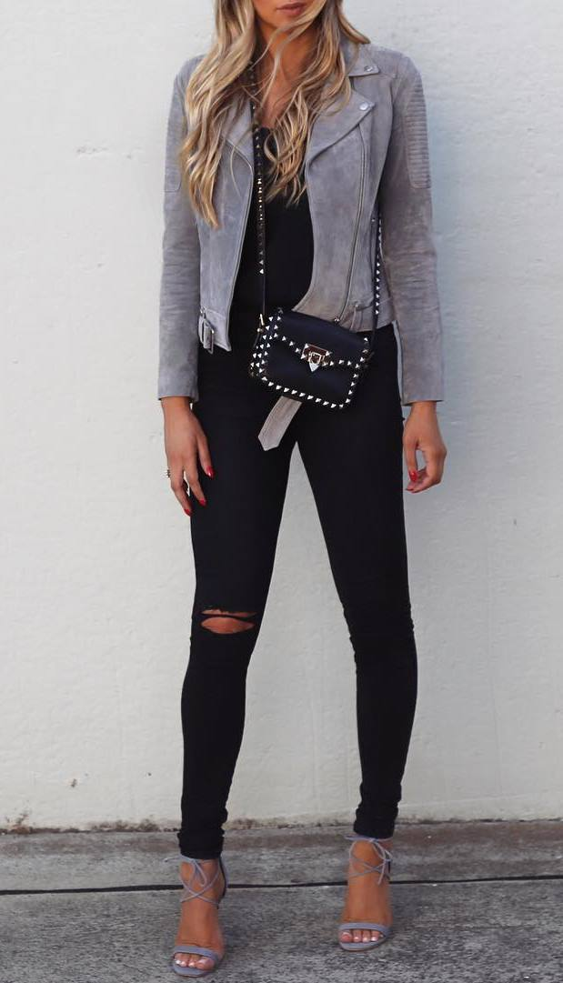 trendy fall outfit / grey moto jacket + crossbody bag + black rips + heels + top