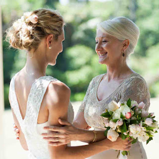 Mother embraces daughter bride
