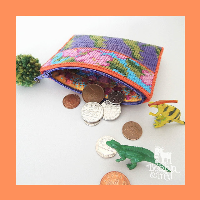 Open coin purse with floral and dinosaur repeat pattern by Bobbin and Fed