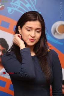 Actress Mannara Chopra Stills in Blue Short Dress at Rogue Song Launch at Radio City 91.1 FM  0008.jpg