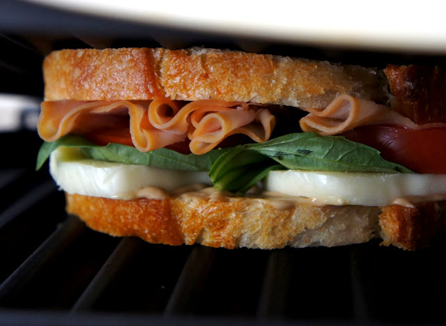 A close up of the inside of a Turkey Caprese Panini