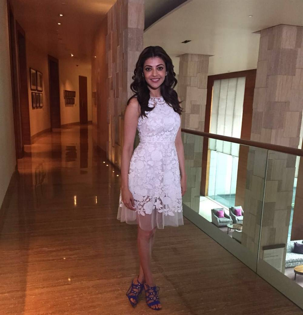 Actress Kajal Aggarwal Legs Thighs Show Stills In White Mini Skirt