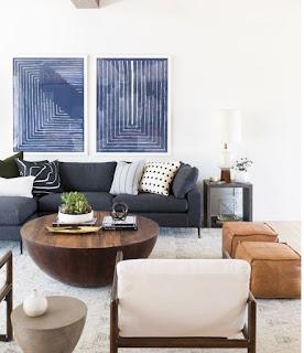 blue grey sofa wallart natural side table