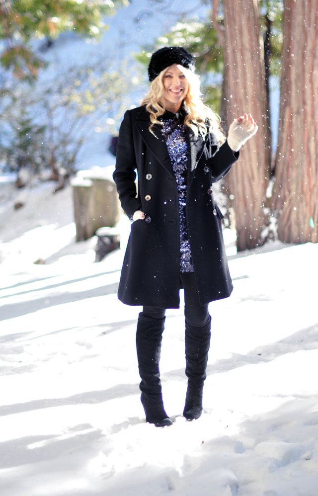 blue sequined mini party dress with boots and a coat