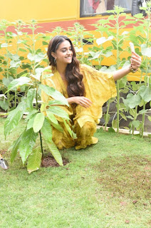 Keerthy Suresh in Yellow Dress with Cute and Awesome Lovely Smile While Planting a Plant