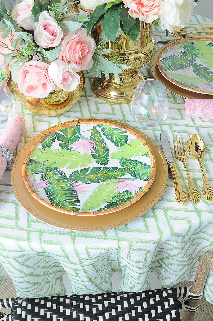 A preppy pink, green, gold and white tablescape accented with unique dinnerware and lots of peonies. Great mix of vintage and new pieces.