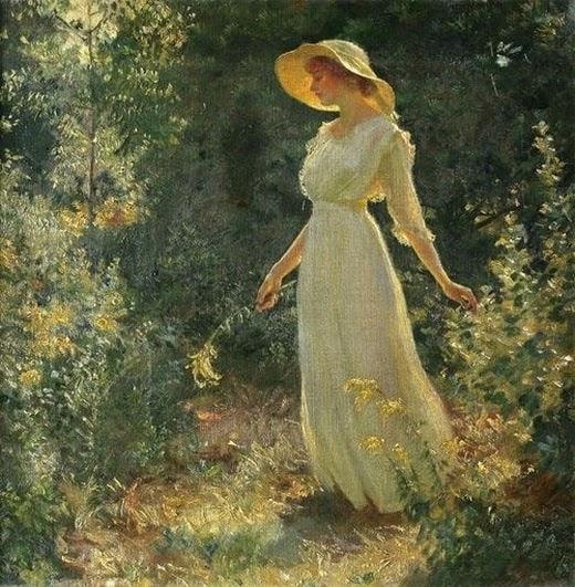 Beautiful woman walking in garden