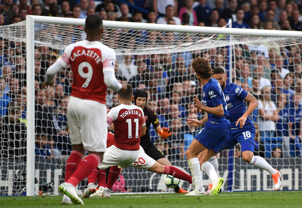 Marcos Alonso of Chelsea scores his team's third goal during the Premier League match between Chelsea FC and Arsenal FC at Stamford Bridge on August 18, 2018 in London, United Kingdom. (Aug. 17, 2018 - Source: Shaun Botterill/Getty Images Europe)