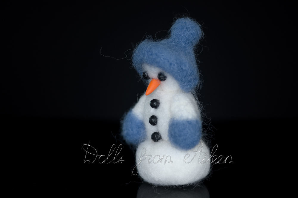 ooak needle felted snowman (with carrot nose, coal eyes and buttons), view from side