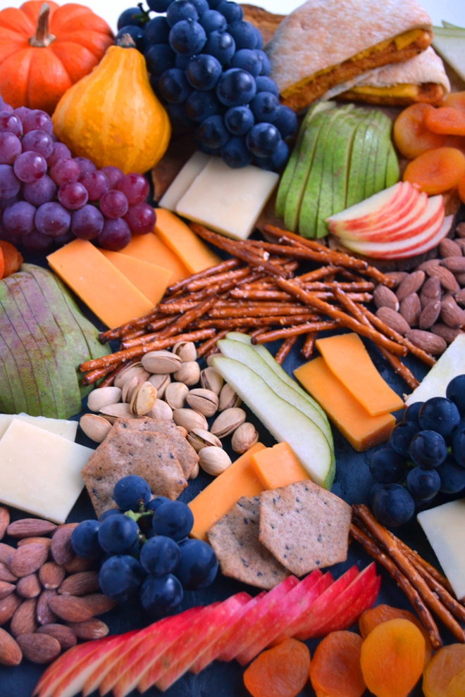 Fall Cheese Board is perfect for entertaining, takes 5 minutes to put together and is filled with your favorite cheeses, grapes, apples, pears, nuts, pretzels, mini sandwiches and more! www.nutritionistreviews.com