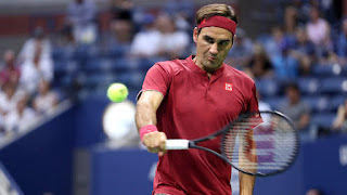 Federer makes short work of Nishioka