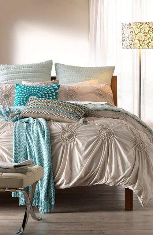 glamorous silver and turquois bedding in a bedroom