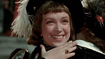 «Двенадцатая ночь»    советский полнометражный цветной художественный фильм,  поставленный на Киностудии «Ленфильм» в 1955 году режиссёром Яном Фридом  по одноимённой пьесе Уильяма Шекспира.    Во время бури на море корабль терпит кораблекрушение, и пучина разлучает двух близнецов: девушку Виолу и юношу Себастьяна. Девушка попала в страну Иллирию, позже туда же прибудет и её брат. Виола встретит и полюбит герцога Орсино. И, чтобы быть ближе к нему, переодевшись в мужское платье, поступает к нему на службу под именем Цезарио. Орсино, влюблённый в красавицу Оливию, отправляет к ней «Цезарио», чтобы его юный «товарищ» поведал Оливии о любви Орсино. Но Оливия влюбляется в «Цезарио». В доме Оливии проживает развесёлая компания — её дядя сэр Тоби, слуги Мария и Фабиан, шут Фесте. Эта компания развлекается как может. Одной из их жертв является гостящий в доме рыцарь Эндрю Эгьючийк. Объектом злой шутки стал и спесивый Мальвольо, дворецкий Оливии. В итоге, после ряда комичных, а подчас и драматичных ситуаций, когда Себастьяна принимают за Виолу и наоборот, разлучённые брат и сестра вновь вместе. Себастьян находит своё счастье в браке с Оливией, а Орсино понимает, что девушка, к которой он испытывает подлинные чувства, — вовсе не Оливия, а Виола.  В ролях  Клара Лучко — Виола / Себастьян, её брат Алла Ларионова — графиня Оливия Вадим Медведев — Орсино, герцог Иллирийский Михаил Яншин — сэр Тоби Белч, дядя Оливии Георгий Вицин — сэр Эндрю Эгьючийк Василий Меркурьев — Мальволио, дворецкий Бруно Фрейндлих — Фесте, шут Анна Лисянская — Мария, камеристка Сергей Филиппов — Фабиан, слуга Сергей Лукьянов — Антонио, капитан корабля, друг Себастьяна Александр Антонов — Капитан корабля, друг Виолы  В эпизодах  Сергей Карнович-Валуа — Валентин, посланник герцога П. Лукин Лев Степанов — стражник, в сценах ареста Антонио, а также моряк (пират) с повязкой на глазу, играющий в кости Александр Захаров — Курио, вельможа в красном рядом с Цезарио А. Востоков Нина Ургант — молоденькая служанка О