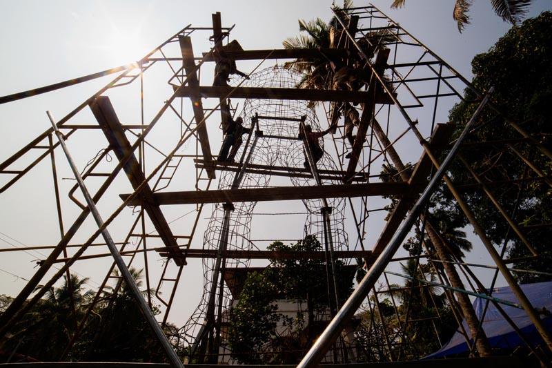 A thirty seven feet high steel framework of this year's Pappanji under progress near INS Dronacharya, Fort Kochi.