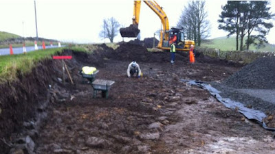 Roman road unearthed at Hadrian Wall car park