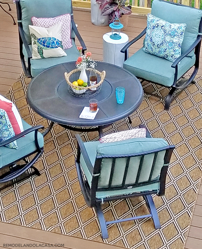 summer decor with blue and coral, pillow cases, agave outdoor rug