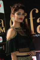 Ritika Singh in a Ethnic Deep Neck Dark Green Choli Ghagra at IIFA Utsavam Awards March 2017 ~ 032.JPG