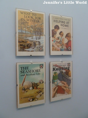 Ladybird book cover postcards on wall display