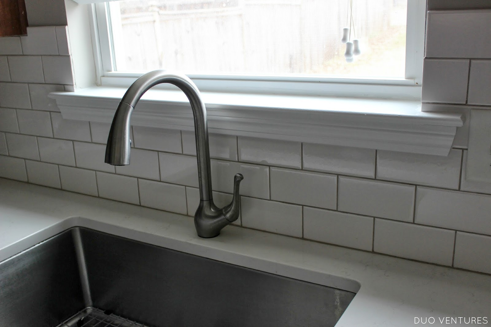 Duo Ventures: Kitchen Update: Paint Touch-ups, Window Sill