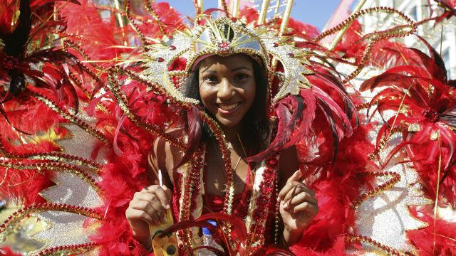 A young woman parading in Notting Hill Carnival