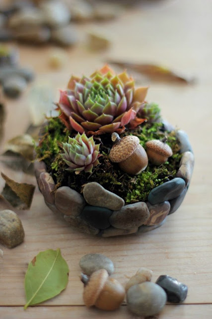http://www.ehow.com/ehow-crafts/blog/how-to-make-a-faux-stone-planter/