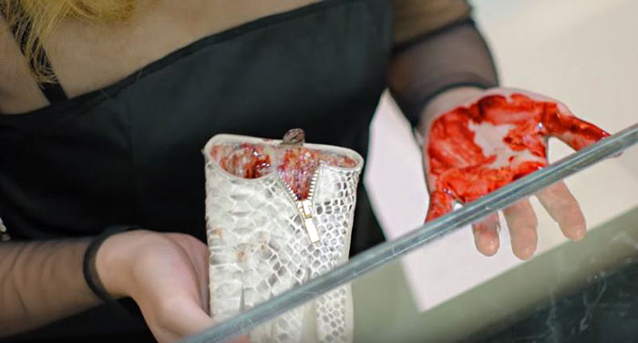 [Watch] PETA Surprises Customers With The Reality Of Leather Accessories - Leather purses, jackets, and even gloves were filled with fake animal flesh and blood.