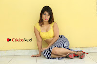 Cute Telugu Actress Shunaya Solanki High Definition Spicy Pos in Yellow Top and Skirt  0282.JPG