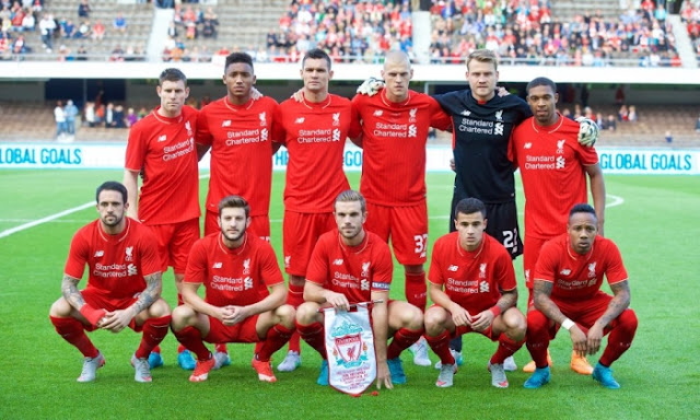 Liverpool players line up for a picture before their 2-0 win away at Helsinki