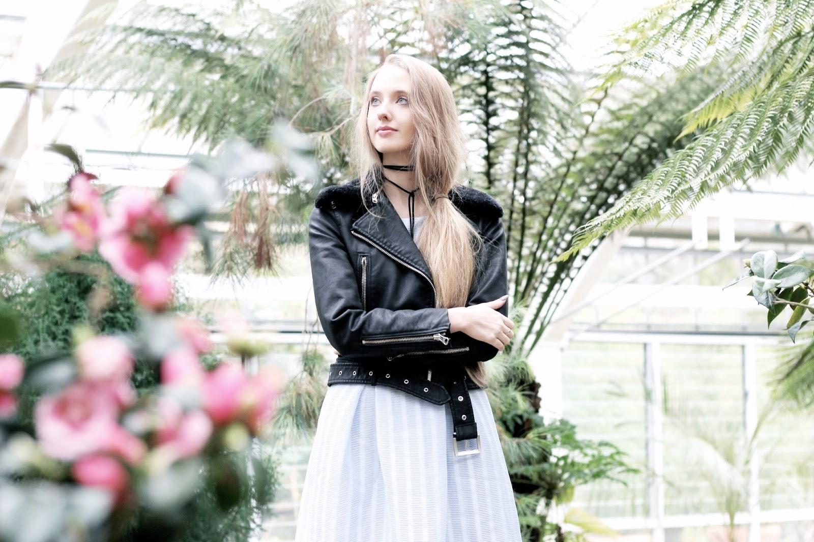 Fashion blog photoshoot in glasshouse greenhouse
