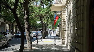 A flag hangs at a wall on a House in Baku