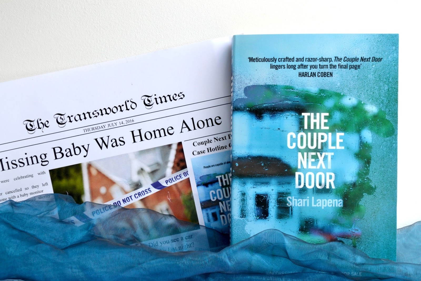 The Couple Next Door by Shari Lapena!